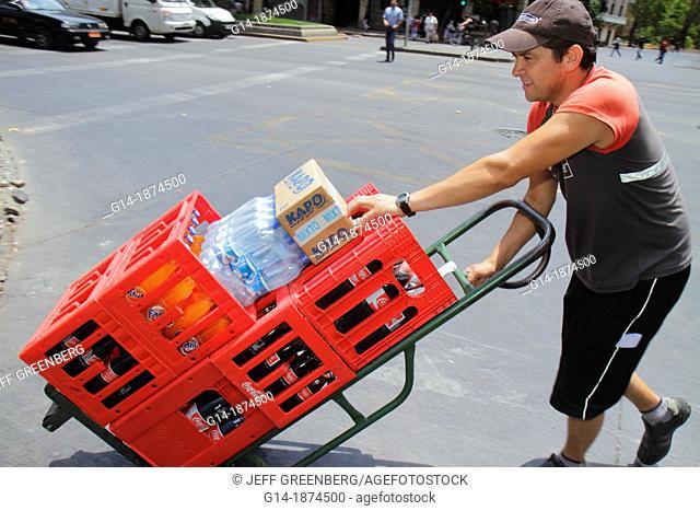 Chile, Santiago, Providencia, Avenida Libertador Bernardo O'Higgins, Hispanic, man, worker, commercial deliveryman, distribution, dolly, crates, soda, push
