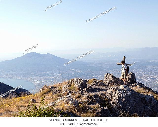 Mountainner child, on the top of Mount Faito, Vesuvio in background, Bay of Naples, Italy
