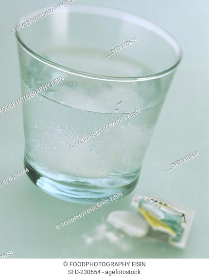 A glass of water with soluble aspirin tablets (2)