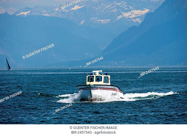 Water rescue motor boat of Morges on Lake Geneva, near Morges with the Vaud Alps at back, Alpes vaudoises, Canton Vaud, Switzerland, Europe