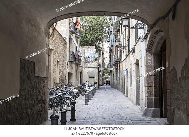 Ancient street in gothic quarter of Barcelona
