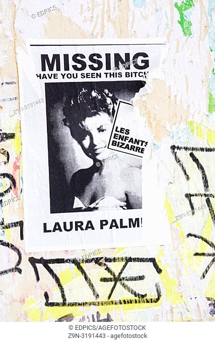 "poster with a photograph of a young woman and a text that reads: """"missing, have you seen this bitch, laura palmer"""", paris, ile de france, france"