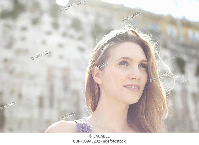 Portrait of a young woman, looking to the future