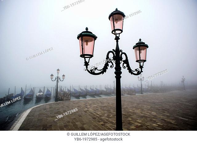 Venice waterfront covered in thick fog, Italy
