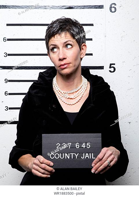 Studio mugshot of mature woman
