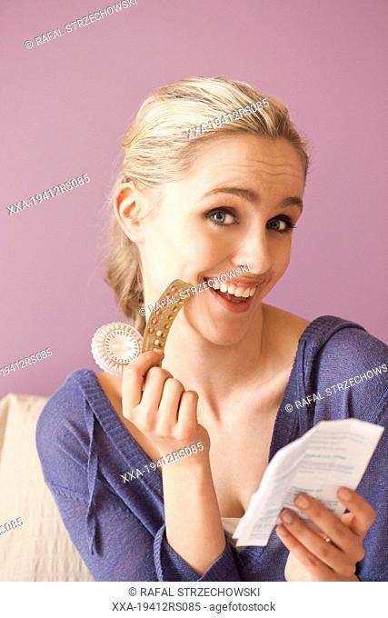 Woman reading pills leaflet