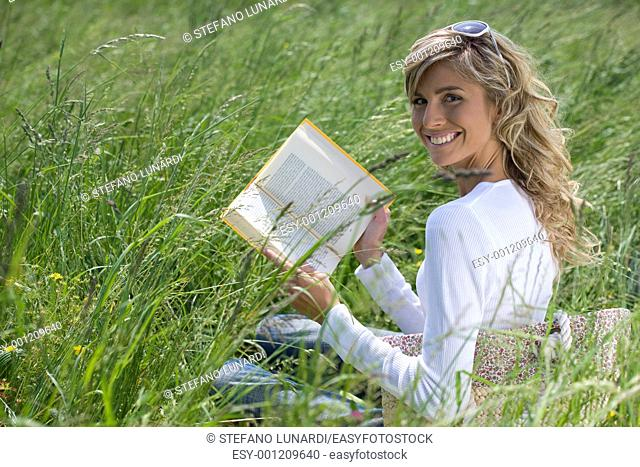 Beautiful Woman Reading Outdoors