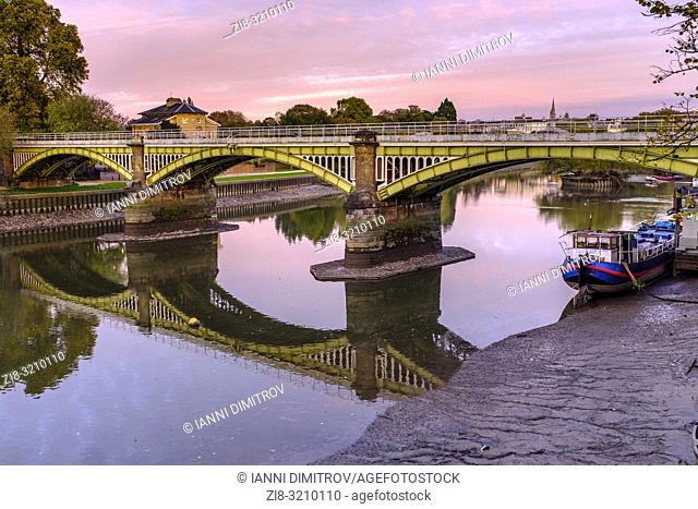 England,Ricgmond-Upon-Thames. River Thames at low tide and Twickenham railway Bridge