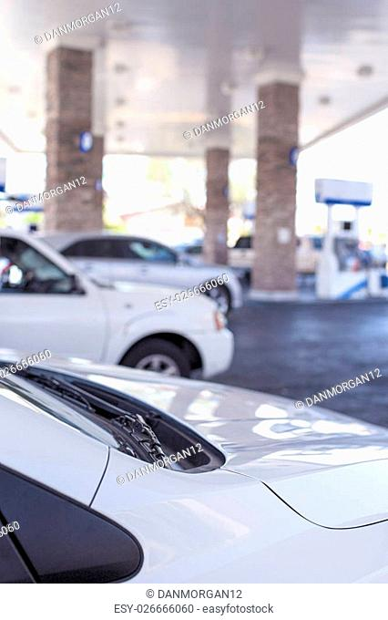 Line of Cars Refilling at Gasoline Station in the Afternoon. Vertical Image Composition