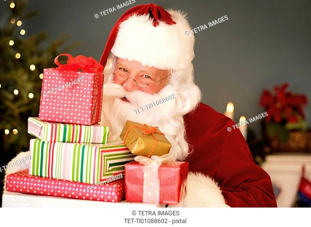 Portrait of Santa Claus holding Christmas presents