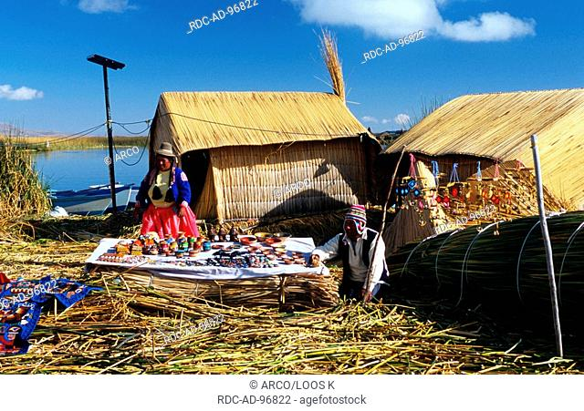 Uros with souvenirs on floating island 'Chumi' constructed from totora reeds, lake Titicaca, Peru, Uru