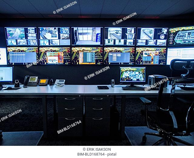 Monitors and empty desk in control room