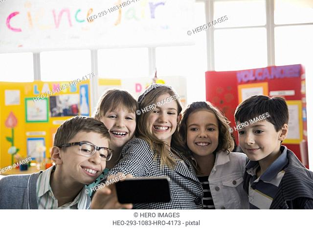 Elementary students taking selfie at science fair