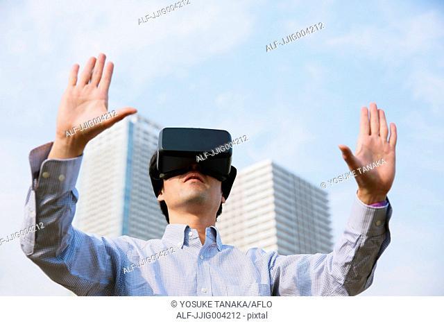 Japanese man using virtual reality device