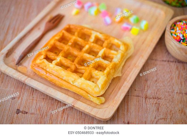 Homemade waffles for breakfast time on wood tray