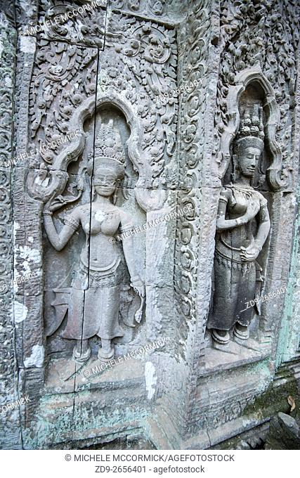 Figures elaborately carved at Ta Prohm Temple in Cambodia