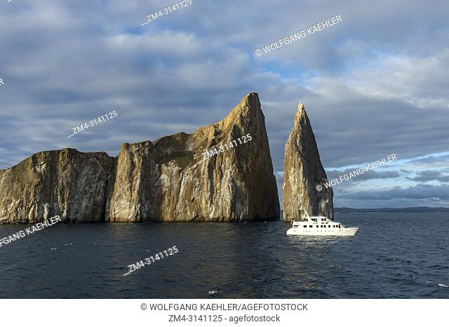 View of Kicker Rock near San Cristobal Island (Isla San Cristobal) or Chatham Island, Galapagos Islands, Ecuador with boat in foreground