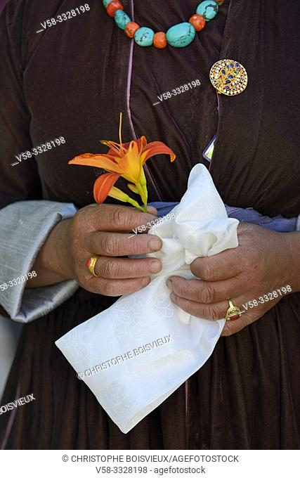India, Jammu & Kashmir, Ladakh, Samsthaling monastery, Ladakhi woman holding a flower and a kata, or ceremonial scarf, to welcome the arrival of the Dalaï Lama