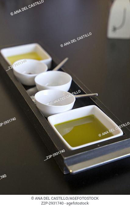 Different olive oil and salt on table restaurant Spain