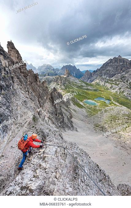 Sesto / Sexten, province of Bolzano, Dolomites, South Tyrol, Italy. Climber on the via ferrata 'De Luca-Innerkofler' to the Mount Paterno