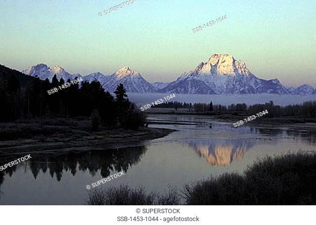 Reflection of a mountain in a river, Teton Range, Grand Teton National Park, Wyoming, USA
