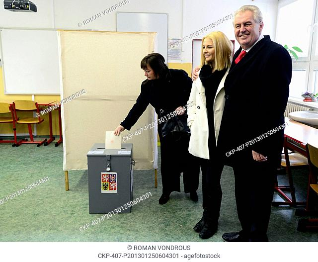 Presidential candidate Milos Zeman with his wife Ivana and daughter Katerina in white cast theirs ballots in the second round of direct presidential election in...