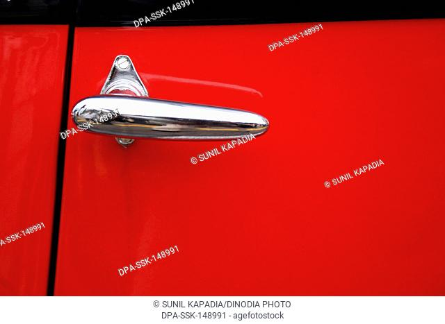 Abstract of a vintage car with it door handle ; Pune ; Maharashtra ; India - Vintage Car It Door Handle Stock Photos And Images Age Fotostock
