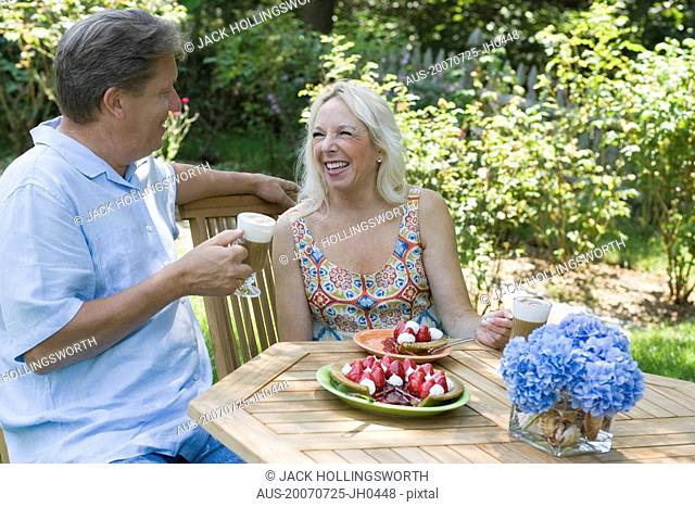 Mature couple sitting at the breakfast table