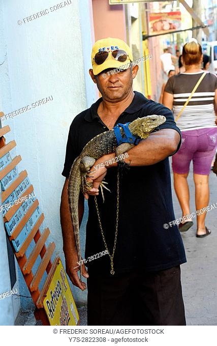 Cuban man with iguana in Santa Clara, Cuba