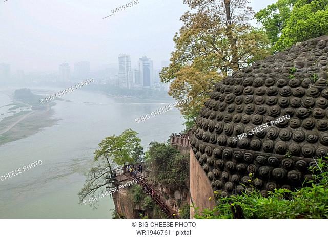 View of a river and distant city from the head of the Leshan giant Buddha, Sichuan province, China