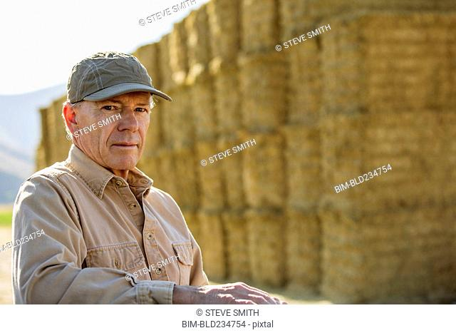 Caucasian farmer near stacks of hay