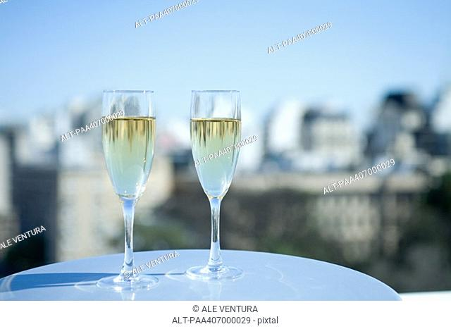 Two glasses of champagne and city skyline