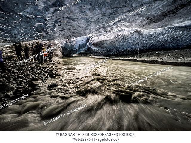 People exploring an ice cave, Breidamerkurjokull Glacier, Vatnajokull Ice Cap, Iceland