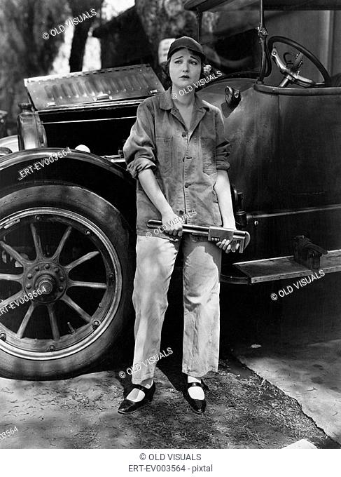 Portrait of female mechanic All persons depicted are not longer living and no estate exists Supplier warranties that there will be no model release issues