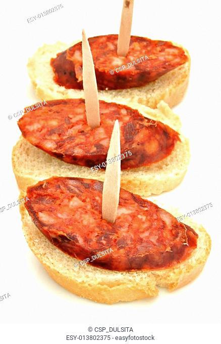 Chorizo sliced piece of bread