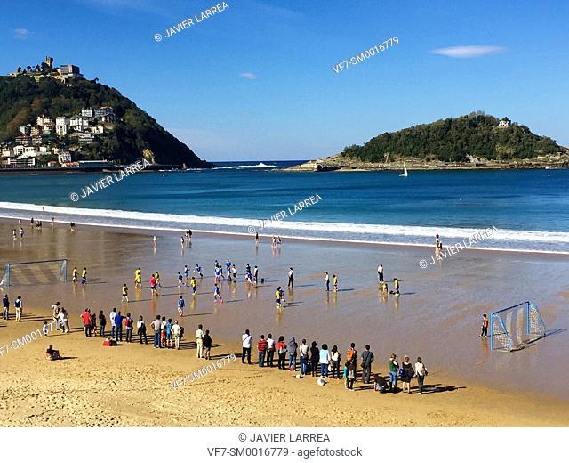Children's soccer games, La Concha beach. Donostia. San Sebastian, Gipuzkoa. Basque Country. Spain