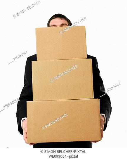 Businessman Overloaded with a Stack Boxes