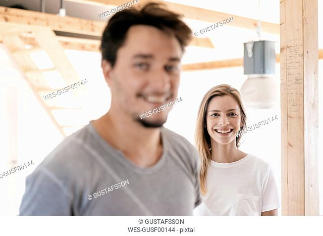Smiling couple in their new home