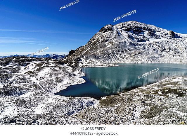 The mountain lake Lajet da Lischana near the valley Val S-charl, Lower Engadine, Switzerland. In the background the mountain Piz Cotschen