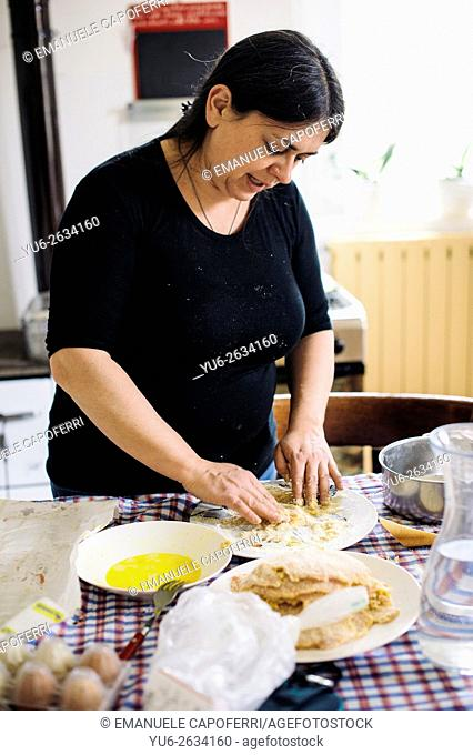 Woman prepare steaks breaded with egg