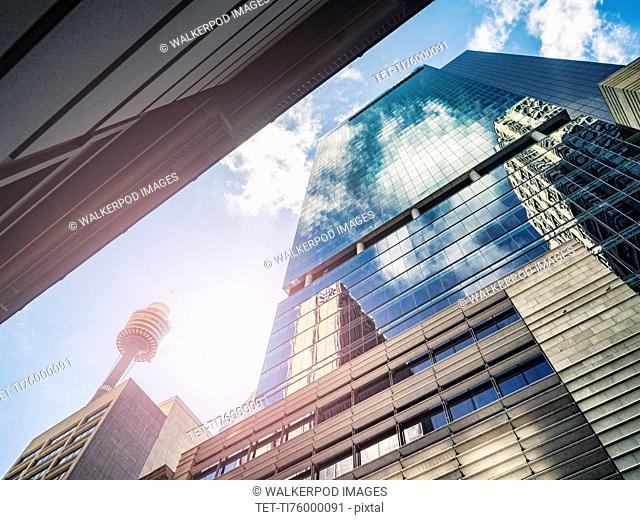 Clouds reflecting in glass buildings