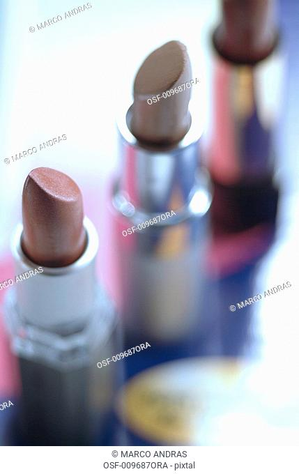 three colorful lipsticks for make up