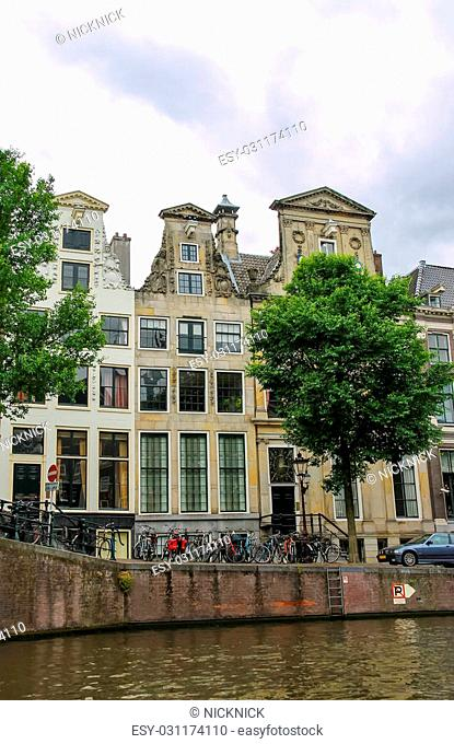 Old buildings on the waterfront canal in Amsterdam