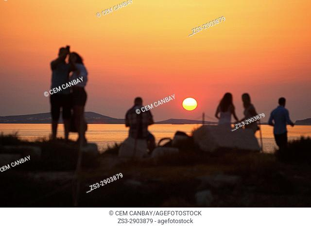 Tourists watching the sunset, Naxos, Cyclades Islands, Greek Islands, Greece, Europe