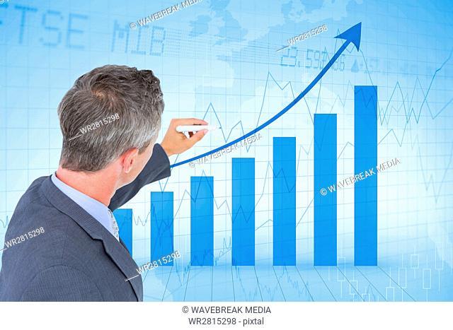 Digital composite image of businessman analyzing bar graph