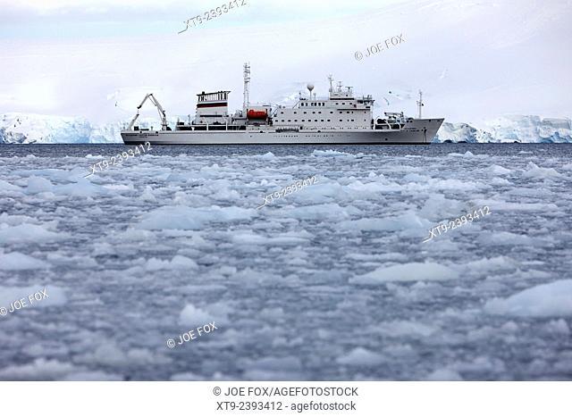 akademik sergey vavilov russian research ship in port lockroy as brash sea ice forming winter closing in Antarctica
