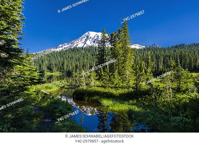 Reflection of Mount Rainier in Reflection Lake on the Stevens Canyon Road in Mount Rainier National Park in Washington State in the United States