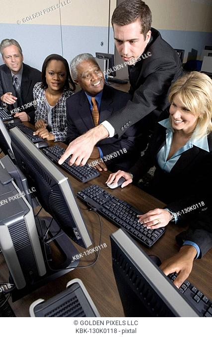 Business colleagues at a computer training seminar