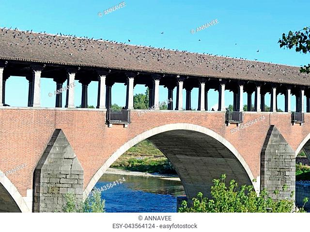 Ponte Coperto (covered bridge) or Ponte Vecchio (old bridge) over the river Ticino in Pavia, Italy