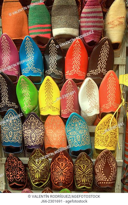 stall selling shoes in the souk of Marrakech. Morocco